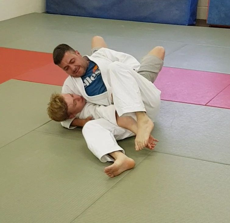 Showing the Ne Waza technique, Hon Kesa Gatame or scarf hold.